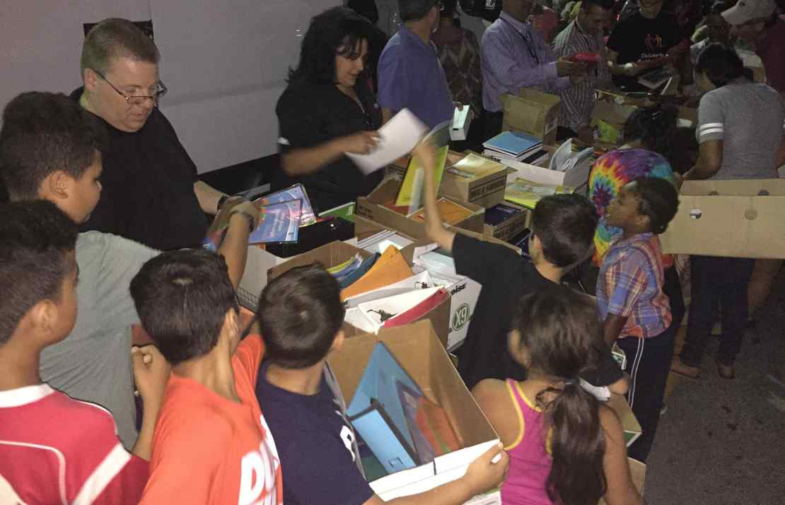 Community Solidarity shares free School Supplies with local children.